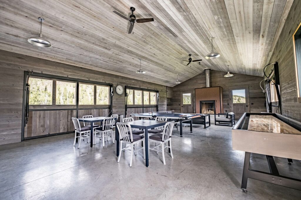 Idaho Rocky Mountain Ranch lodge complete with shuffle board and ping pong, all family friendly and inviting with lounge seating and a group meeting area