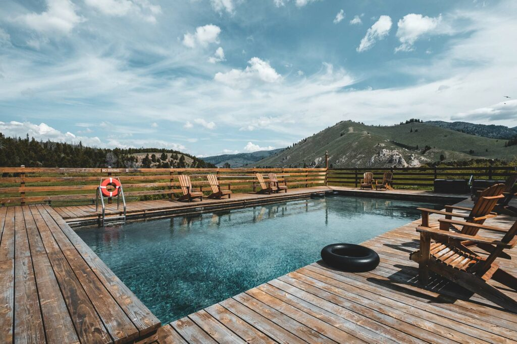 our private mountain hot springs with lounge chairs overlooking beautiful idaho mountains