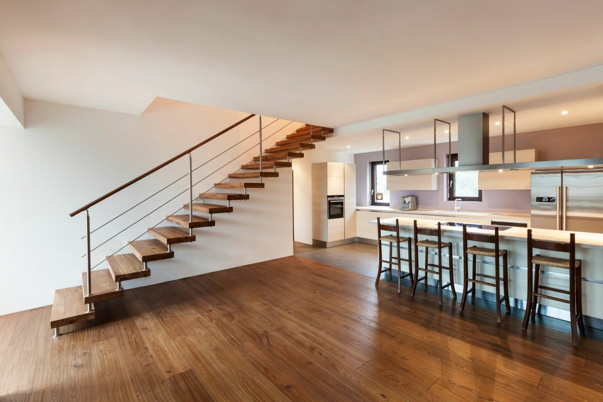 Floor and stairs with hardwood covering