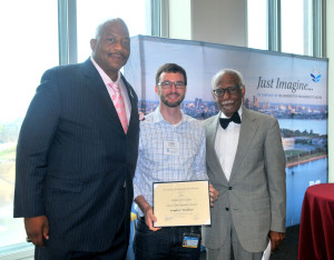 Dr. Woodhams receives the Endowed Faculty Career Development Award,presented by UMass Boston Chancellor J. Keith Motley (pictured left) and UMass Boston Provost Winston E. Langley (pictured right).
