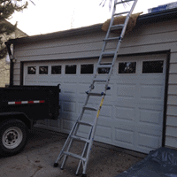 Metal ladder leading up to a roof.