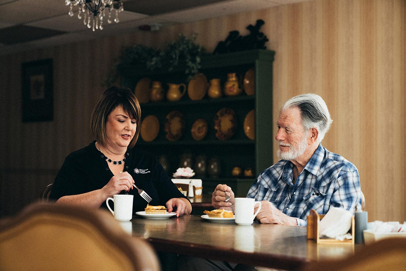man sitting at table with his healthcare provider