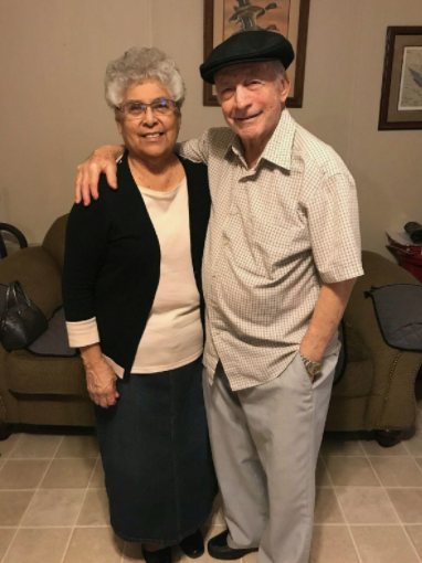 Ruth and Vincent standing next to each other for a picture