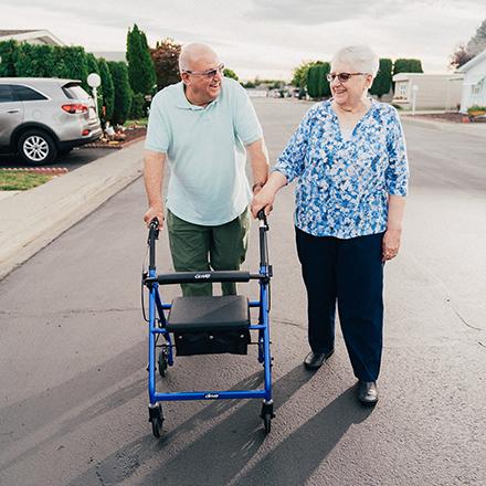 elderly couple walking down the street