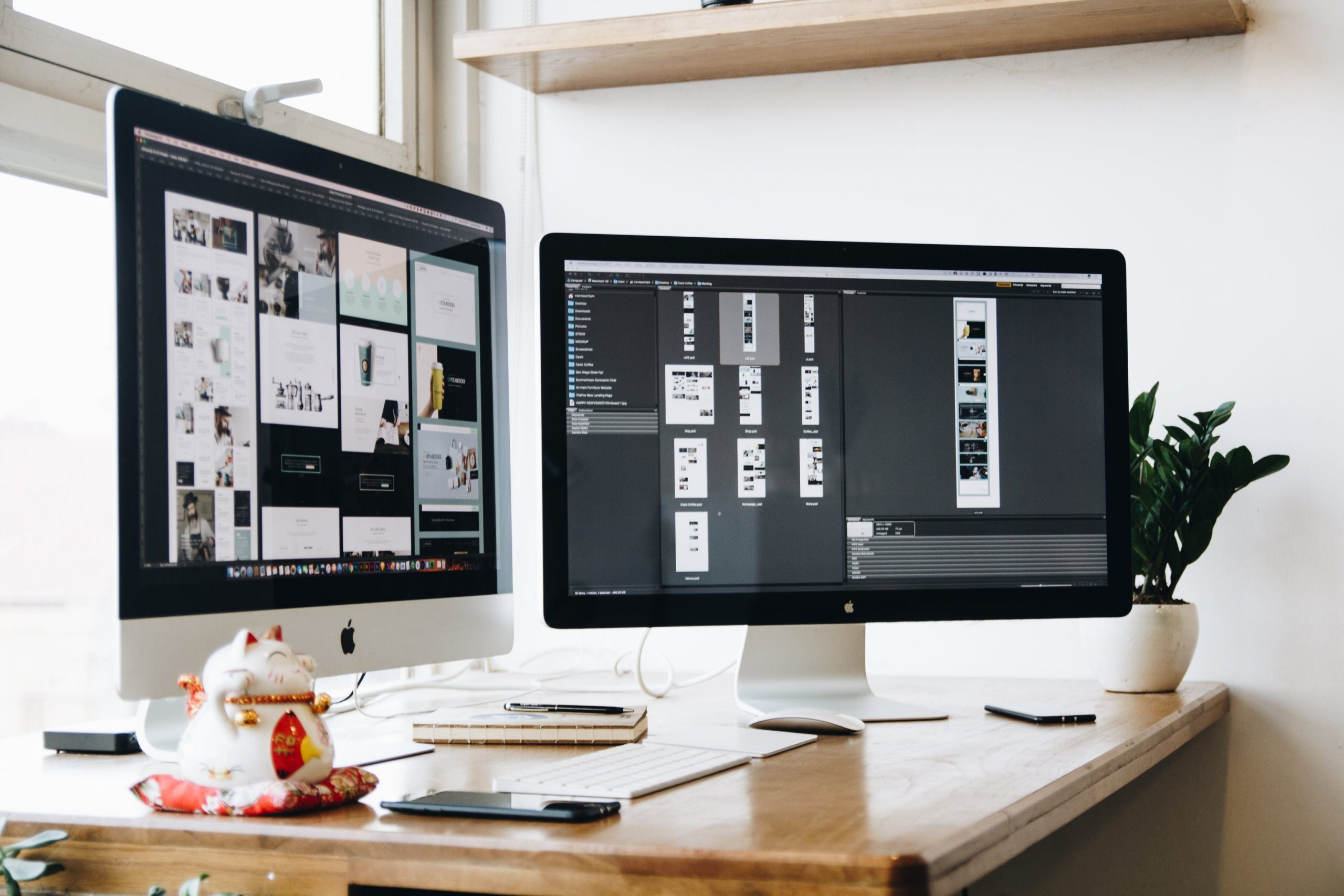 Two iMac screens on a desk, one displaying pictures and another image editing software in use.