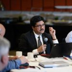 Picture of Dr. Nemy Banthia discussing housing issue