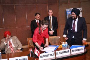 Photo of Honourable Kirsty Duncan signing agreement with other dignitaries in New Delhi, India, February 2018