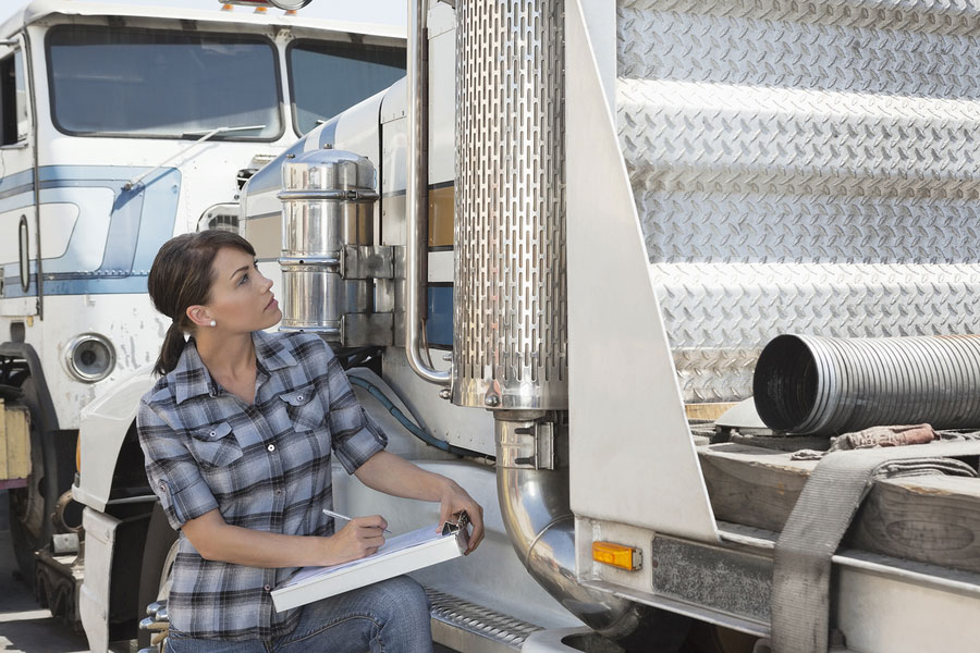 bigstock Woman inspecting flatbed truck 50066150