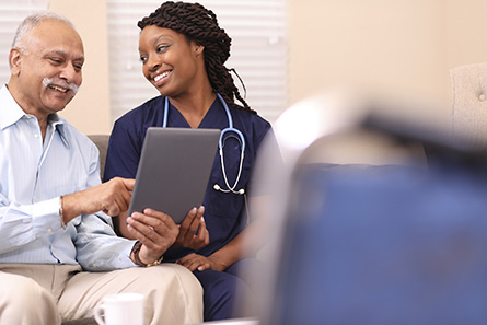 home health care worker getting health history from patient