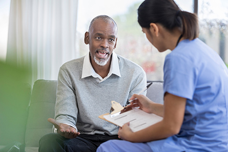 Presidium Health chronic care worker checks in with patient