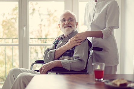 elderly man being cared for by a nurse from Presidium Health's transitional care program