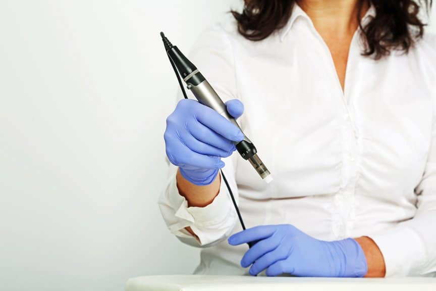Doctor Holding Tool For Facial Treatments