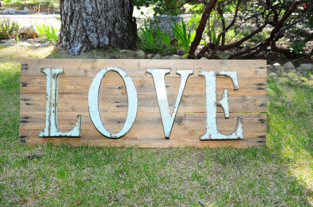 "Metal Love sign on rustic wood stand, 15""X40"" $25"