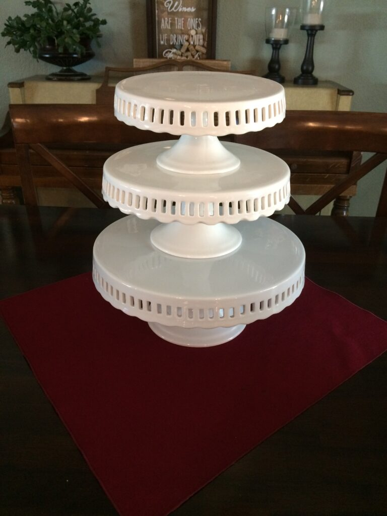 "Tiered cake plates, 8', 9.5"", 11""- stands 14"" high, $30"