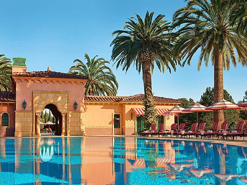 San Diego's luxury Fairmont Grand Del Mar pool and lounge chairs