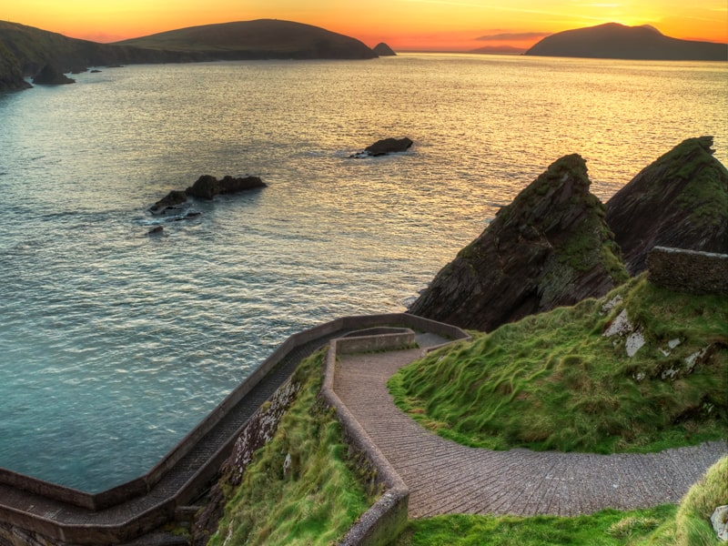 Sunset over pathway leading to Dunquin Pier on Dingle Peninsula, Co.Kerry, Ireland