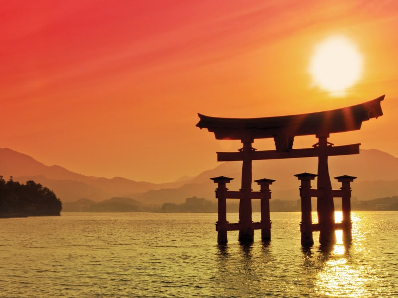 The famous Floating Torii gate in Miyajima, Japan at sunset