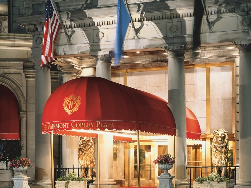 The Fairmont Copley Plaza enterance with lion statues and red awning