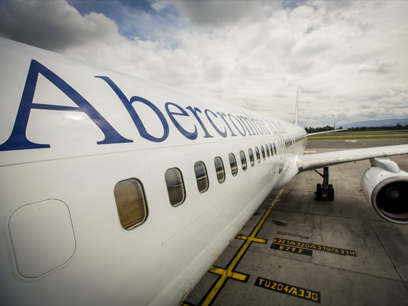 View down the side of an A&K jet with Abercrombie logo on it