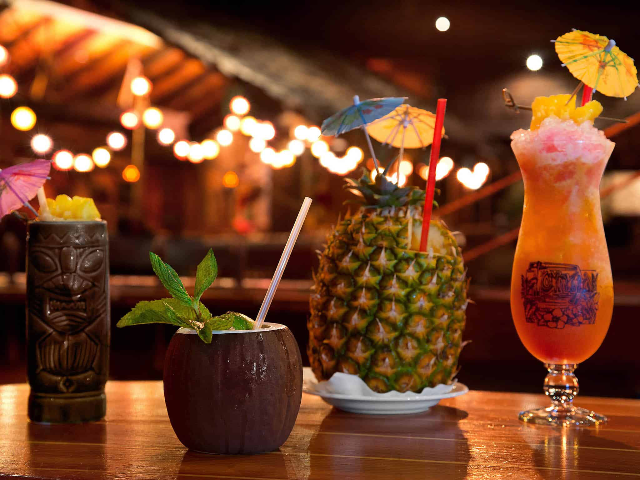 Fairmont San Francisco cocktails, one tiki, on coconut, one pineapple, one fruity drink