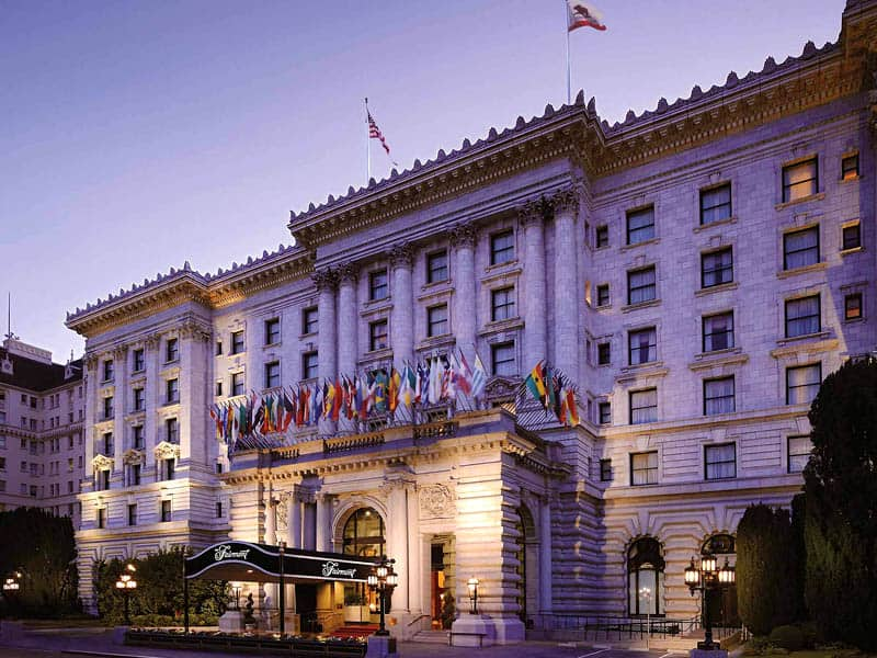 Fairmont San Francisco main enterance at night, with world flags and Fairmont awning