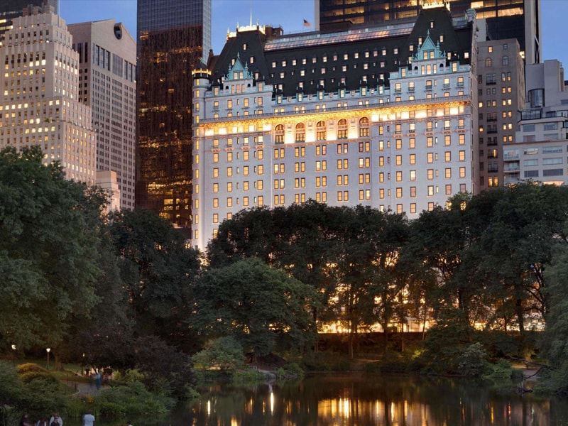 Exterior of The Plaza at night view from Central Park, NYC