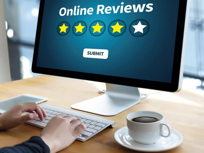 Person filling out online reviews on computer