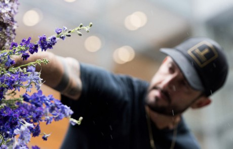Four Seasons Philadelphia florist arranging purple flowers