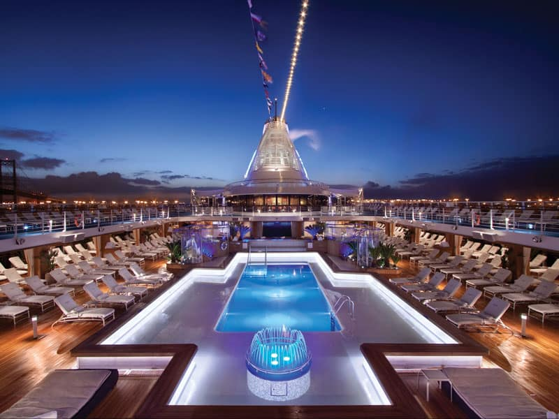 Oceania pool deck photographed at night with blue lights
