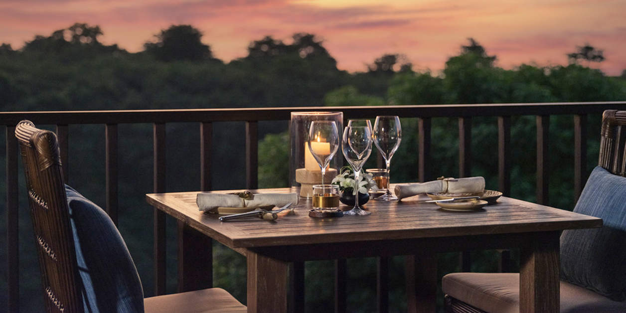 Romantic table for two outside at Raffles Bali at sunset
