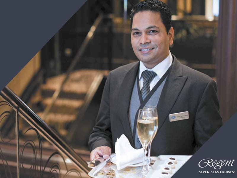 Man serving champagne on tray