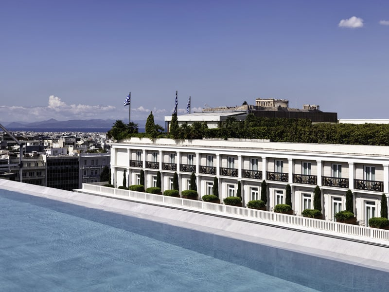 Exterior view of Athens Capital Center Hotel - MGallery Collection with outdoor pool in foreground