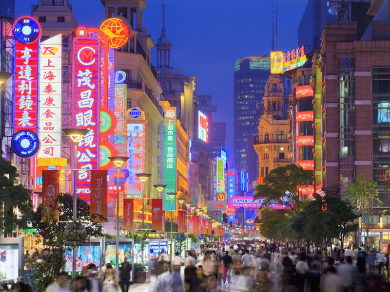 Nanjing Road at dusk, one of the worl'd busiest shopping streets in Shanghai, China.