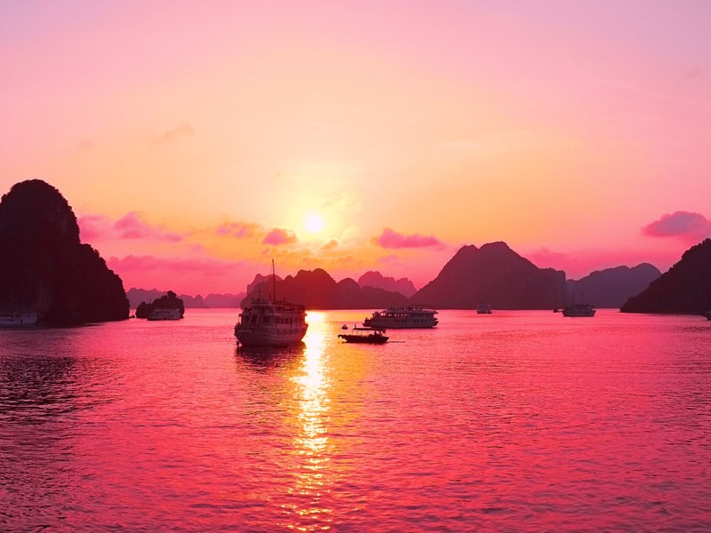 Beautiful purple sunset and rock islands in Halong Bay Vietnam Southeast Asia.