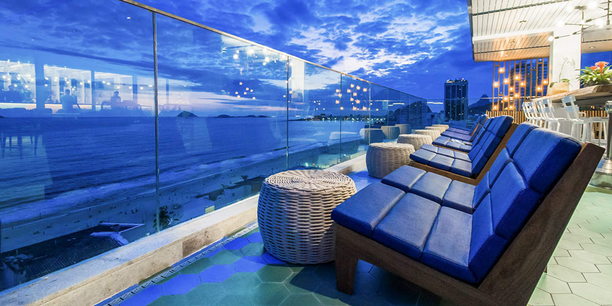 Novotel Rio de Janeiro Leme at night as scene from balcony lounge area looking at night sky and ocean