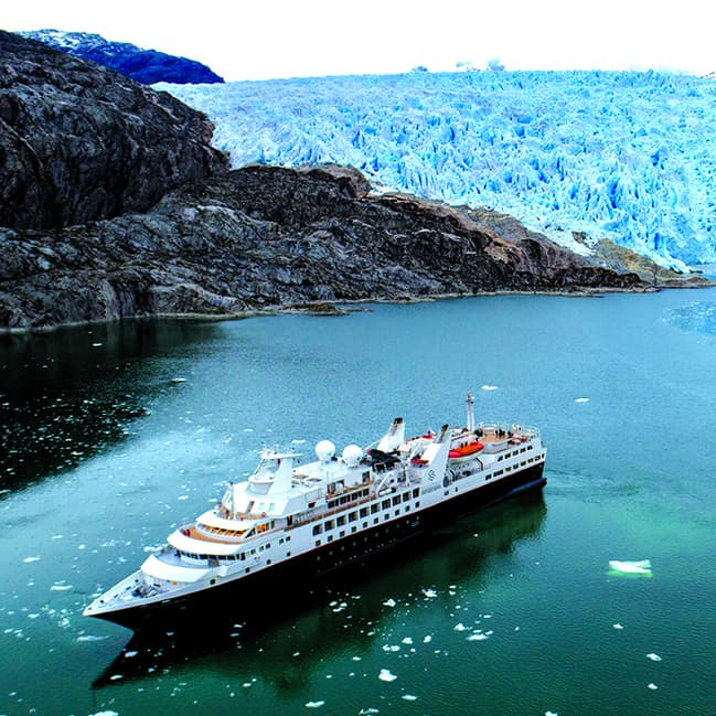 Silversea Explorer sailing past glaciers