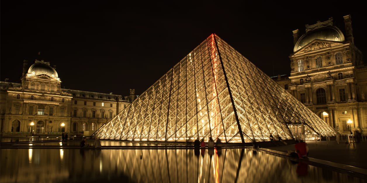 the Louvre Museum in Paris, France, at night