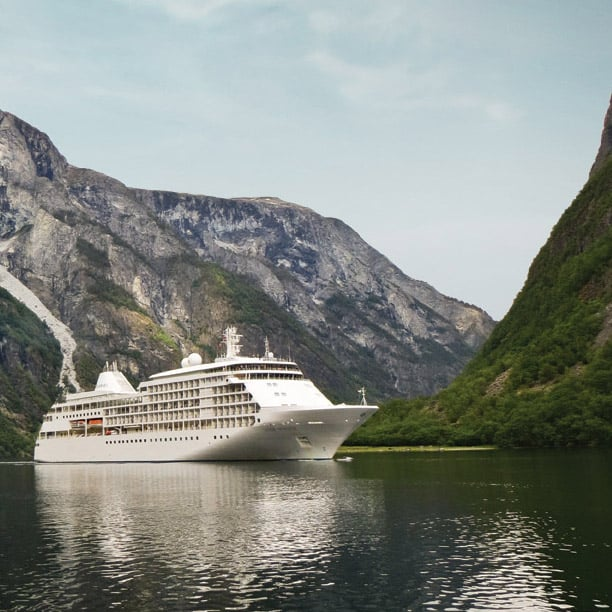 Silversea Whisper sailing between mountains