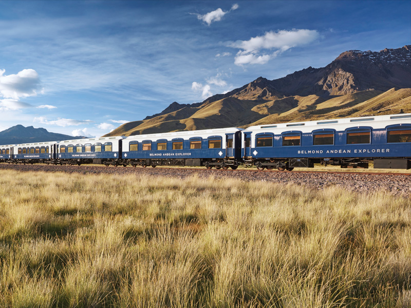 View of Belmond Andean Explorer at La Raya pass, with mountains in background