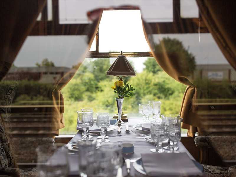 View of table setting and window on the Belmond British Pullman train