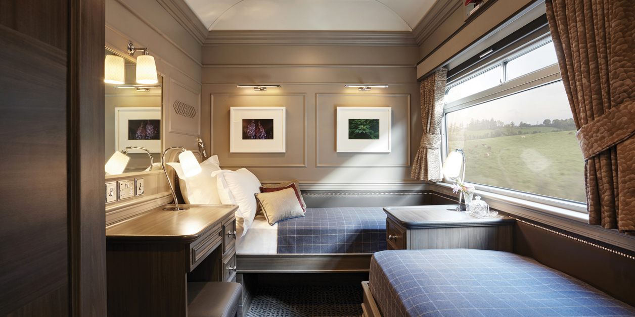Bedroom view of a cabin on the Belmond Grand Hibernian train