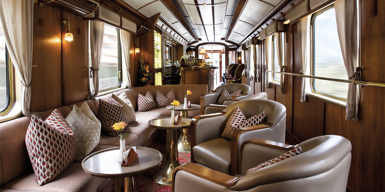 Interior view of tables and chairs on the Belmond Hiram Bingham train