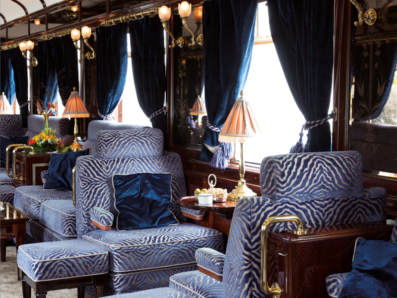 Interior view of Belmond Venice Simplon-Orient-Express with blue and white zebra patterned chairs