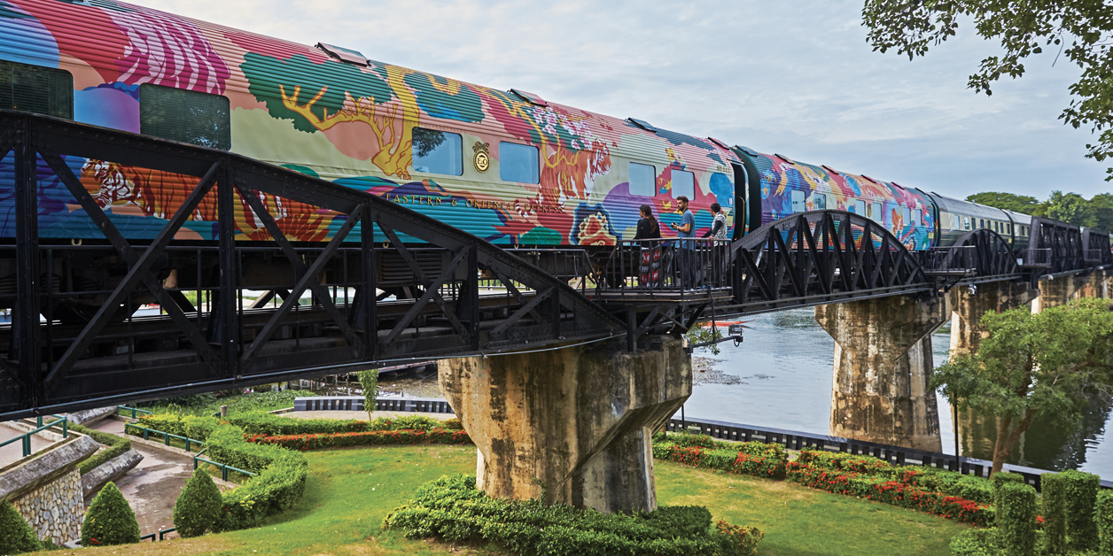 Save the Wild Tigers artwork on the Eastern Oriental Express, seen crossing a bridge