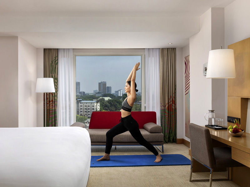Woman doing Yoga in hotel room