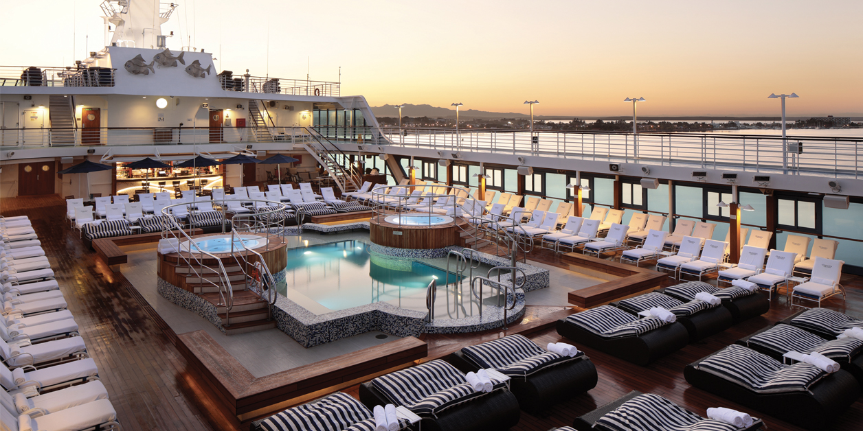 Oceania's pool deck at sunset