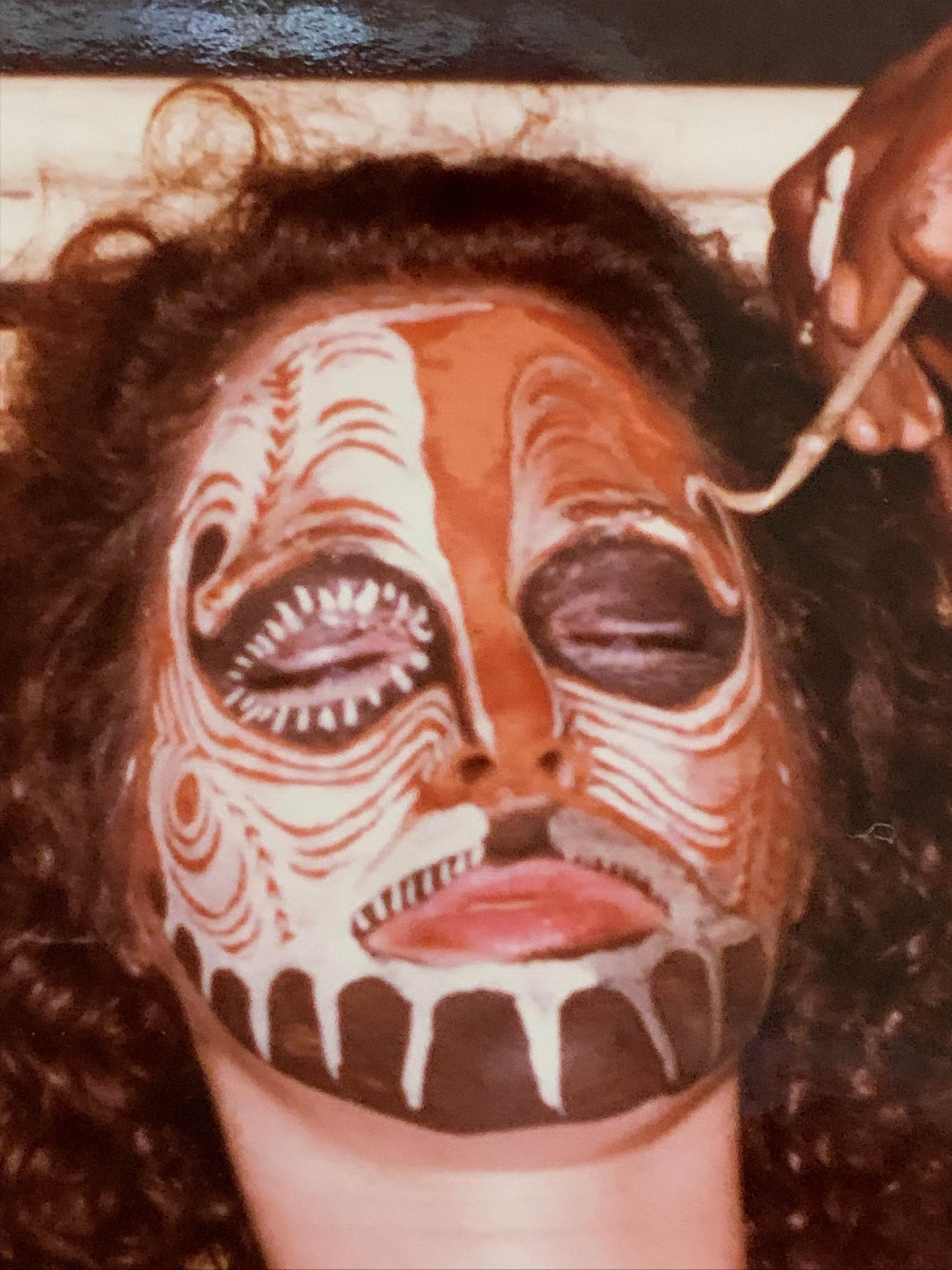 Lisa Novack getting face painted in New Guinea