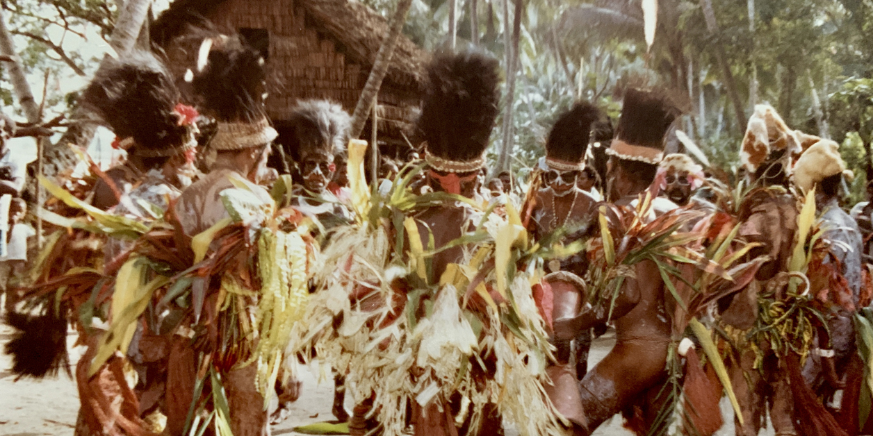 New Guinea tribes in costume performing