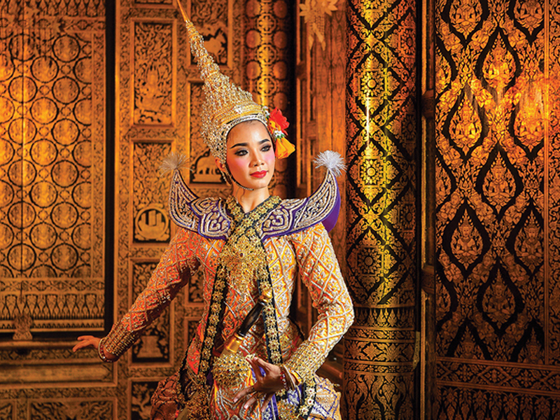 Image of asian woman infront of pattern wall for Oceania's 2023 world cruise