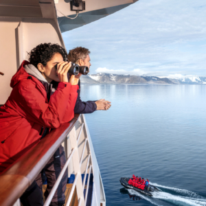 Guests enjoying the view from the Silver Cloud, Monacobreen, Svalbard